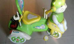 A mumu tricycle hardly used green & yellow in colour