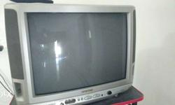 Aiwa 21 inch TV in good condition along with stand.