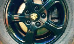 alloy wheel black colour 5 nut perfect condition 15inch