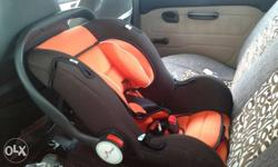 Baby's Brown And Orange Car Seat