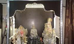 Beautiful mandir with led light and a drawer in it.