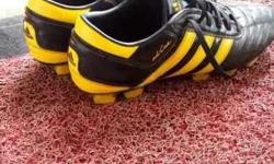Black-and-yellow Adidas Cleats