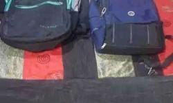 Black-teal And Blue-and-black Backpacks