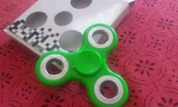 Green and gray fidget hand spinner