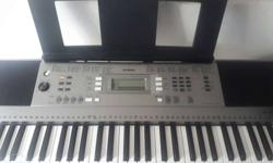 Black And Gray Yamaha Electronic Keyboard