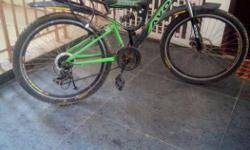 Black And Green Avon Full Suspension Bicycle...