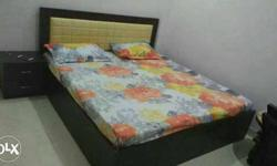 King size bad and Floral Bed Linen Brown Wooden Bed