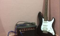 Black Yamaha Electric Guitar With Yamaha Speaker