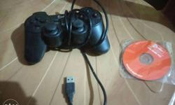 Black Game Controller And Compact Disc In Pack price