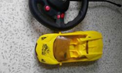 Black Game Electronic Steering Wheel And Yellow R/C Car