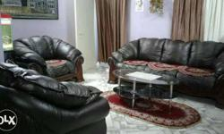 Black Leather Couch With Two Armchairs And Coffee Table
