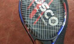 Black, Red, And Blue Cosco Tennis Racket With Head