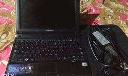 Black Samsung Laptop With AC Adapter