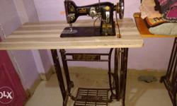 Black Sewing Machine In Table