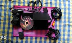Black Sony Ps2 Console And Controller With Game