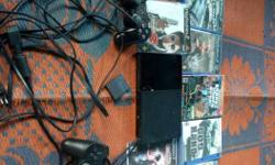 Black Sony PS2 With Controllers And Games