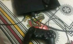 Black Sony PS4 500gb With Game Controller and a game.