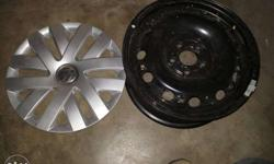 Black Volkswagen Wheel And Gray Hub Cap