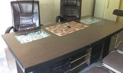 Black Wooden Desk With Two Brown Leather Armchairs
