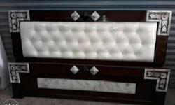 Black Wooden Frame White Leather Padded Bed