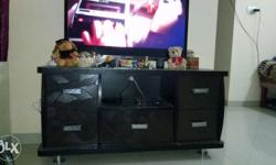 Black Wooden Television Stand Almost New. No scratches