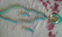 Blue color beaded chain with pendand and earrings