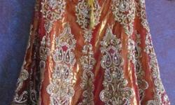 its a designer wear bridal lehnga with stiched blouse