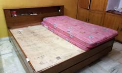Brown And Beige Wooden Bed Frame And Two Pink