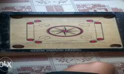 Brown And Black Wooden Carrom board. 18*18 inch small