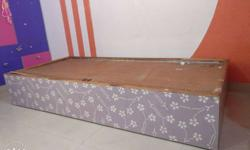 Brown And Purple Floral Wooden Bed