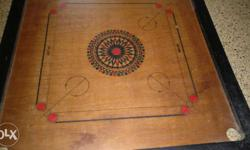 Brown, Red And Black Carrom Board