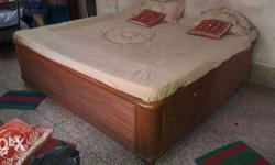 Polished Brown Wooden Bed With double box beds.