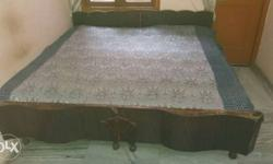 Brown Wooden Bed And White Floral Bed Cover can be sold