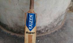 Brown Wooden Kaizen Cricket Bat. Price slightly