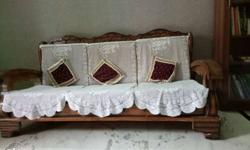 Brown Wooden Sofa With White Clothe Cover