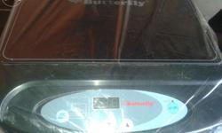 Butterfly induction stove old sale good working