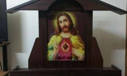 Candle stand / shelf with the image of Jesus placed