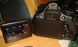 Canon 600D black less used 1yr completed still in 1year