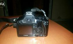 Canon 1000D in good condition camera body, chrger,