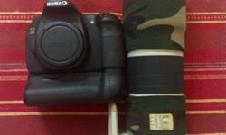 Canon eos 60 d with battery grip and canon 300 mm f4 is