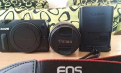 Canon eos m for good photography . have 18-55 mm lence