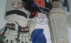 Cricket kit complet with a leg pad, thig pad, hand
