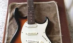 White, Brown, And Black Electric Guitar