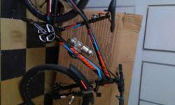 Black , Red And Blue Hard Tail Mountain Bicycle