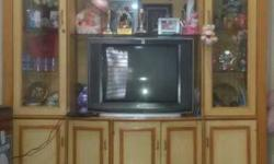 CRT Television With Brown Wooden TV Hutch