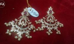 Cz and small ruby stone hanging motis Chandbali. To