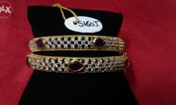 Designer box shape with cz and middle ruby exclusive