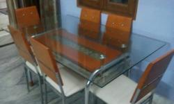 DINING TABLE ,1 YEAR OLD IN EXCELLENT CONDITION , 6