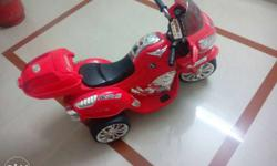 Electric bike for kids ride with musical speaker also