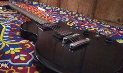 Black Cutaway Electric Guitar,less used ,fret excellent